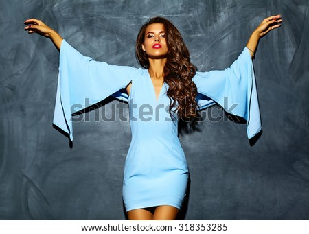 fashion glamor stylish beautiful  funny crazy young woman model with red lips in summer bright colorful hipster blue dress near gray wall - stock photo