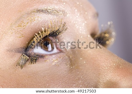 Fashion gold make-up, women eye close-up - stock photo