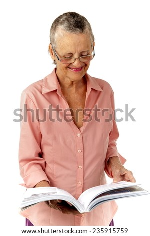 Fashion hair senior reading a book and smilling . - stock photo