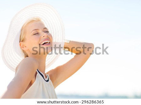 fashion, happiness and lifestyle concept - beautiful woman in hat enjoying summer outdoors - stock photo