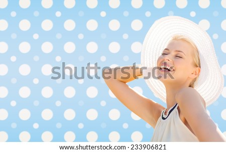 fashion, happiness and people concept - beautiful smiling woman in white summer hat over blue and white polka dots pattern background - stock photo