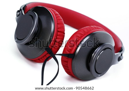 Fashion headphones made of red leather on a white background. - stock photo