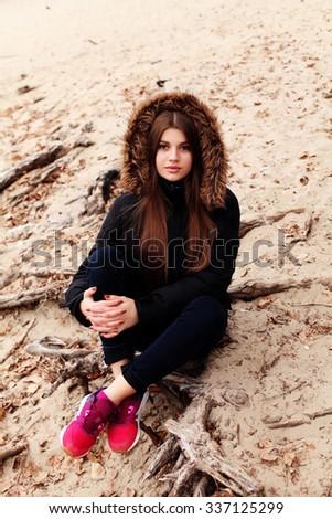 Fashion hipster woman wearing parka.  - stock photo