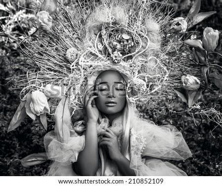 Fashion image of sensual girl in bright fantasy stylization. Black-white outdoor fairy tale art photo. - stock photo