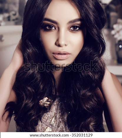 fashion interior photo of beautiful sensual woman with long dark hair wears elegant dress,posing at bedroom - stock photo