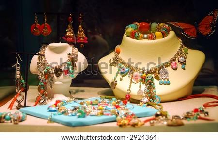 Fashion jewelry displayed in a jewelry store window - stock photo