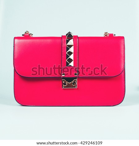 fashion ladies pink handbag isolated on white background