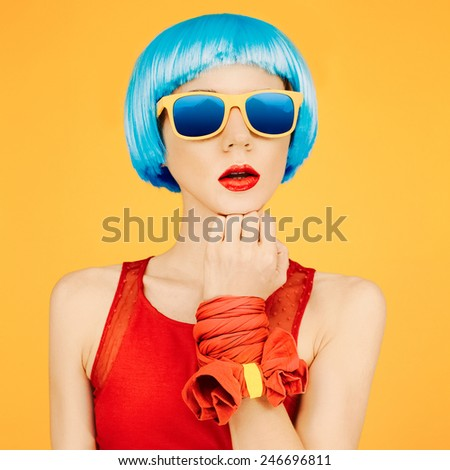 Fashion Lady in blue wig and sunglasses on bright yellow background - stock photo