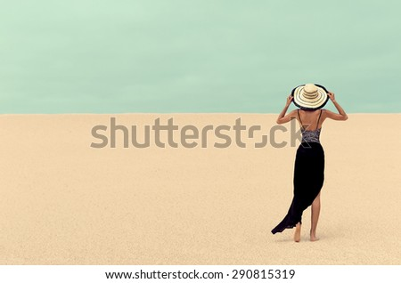 Fashion Lady  in the Desert on Vacation - stock photo