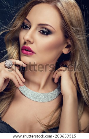 Fashion lady, sensual blonde woman with shiny jewelry in evening dress - stock photo