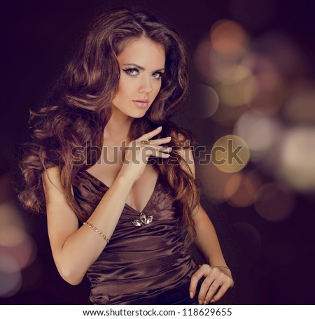 Fashion lady, sensual brunette woman with shiny curly silky hair in elegant dress - stock photo