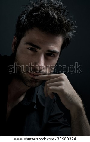Fashion latin man looking at camera with confidence - stock photo