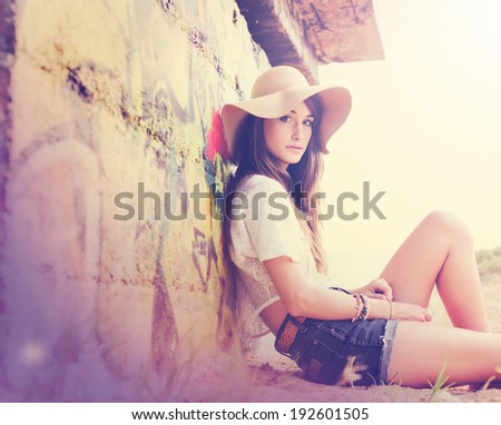 Fashion Lifestyle, Beautiful girl at the beach. Instagram colors with lens flare and light leak. Trendy hipster colors and style. - stock photo