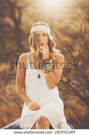 Fashion Lifestyle, Portrait of Beautiful Young Woman Backlit at Sunset Outdoors. Soft vintage warm colors. - stock photo