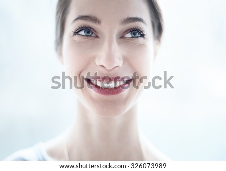 Fashion lifestyle portrait of young happy pretty woman laughing and having fun on the street at nice sunny summer day - stock photo