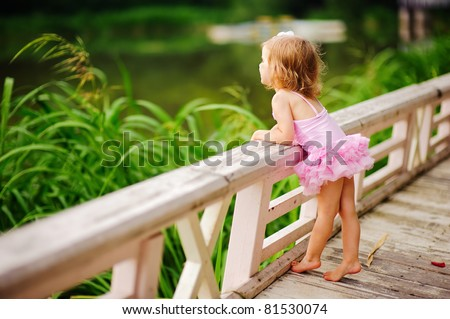 fashion little girl in tutu swimsuit have a fun outdoor - stock photo