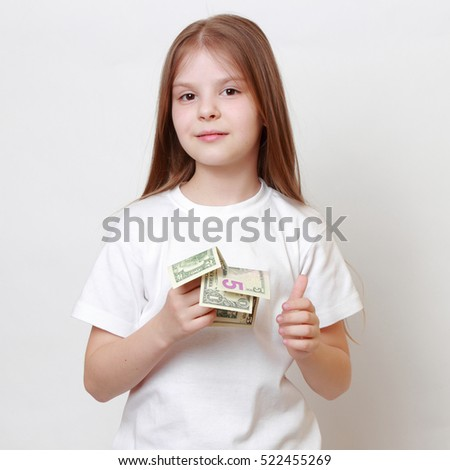 Fashion little girl with cash money dollars USA