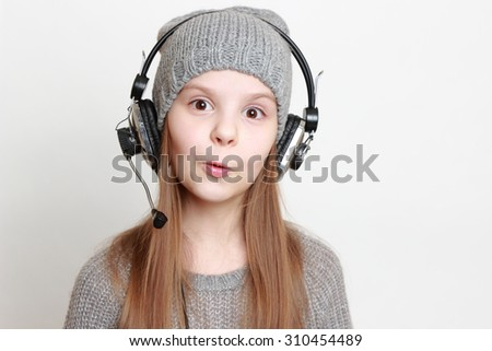 Fashion little girl with headphone singing
