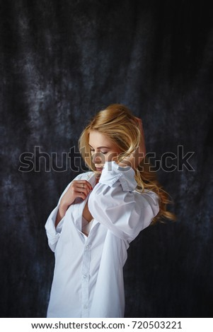 fashion luxury blonde girl in man's shirt