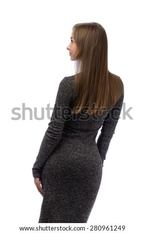 Fashion luxury portrait of young girl in gray style dress with long healthy glossy brown hairs posing back side. On white background in studio isolated closeup. - stock photo