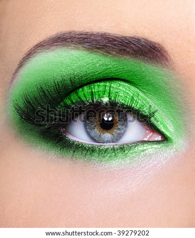 Fashion make-up of woman eye with green eyeshadows - stock photo