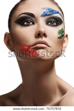 Fashion make-up with face art. Close-up portrait of beautiful young woman isolated on white background. - stock photo