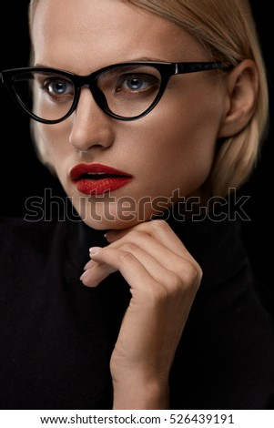 Fashion Makeup Model With Red Lips And Black Eye Glasses. Beautiful Woman Face With Sexy Red Lipstick And Retro Design Eyewear. Female Wearing Optical Eyeglasses Frame. Beauty Concept. High Resolution