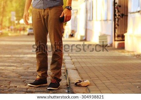 Fashion male look. Detail of trendy clothes stylish young handsome man outdoors in the city - stock photo