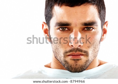 fashion male portrait with a very agressive and intense stare - isolated over a white background - stock photo