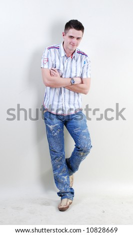 Fashion man at white background in jeans - stock photo
