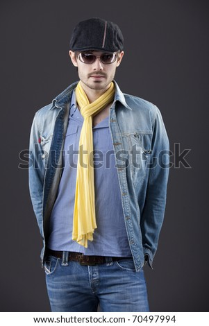 fashion man in denim clothes over grey background - stock photo