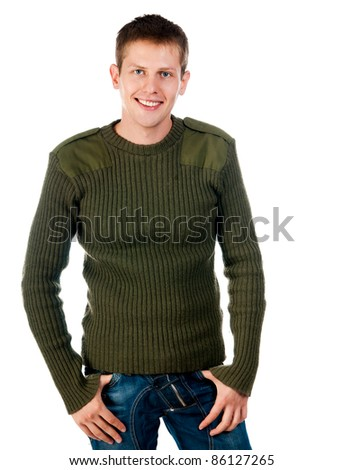 fashion man in studio looks at camera - stock photo