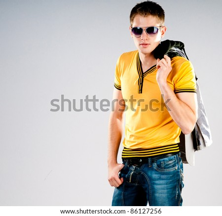 fashion man in sunglasses on grey background - stock photo