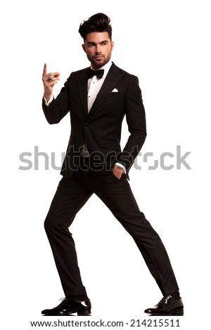 fashion man in tuxedo snapping his finger , full body picture on white background - stock photo