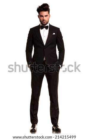 fashion man in tuxedo standing with hands in pockets, full body picture on white background - stock photo