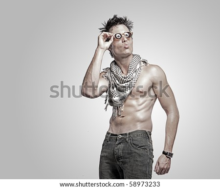 fashion man portrait isolated over a grey background