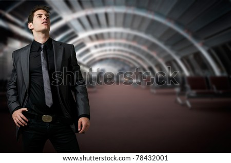 Fashion man with suit posing  at modern office - stock photo