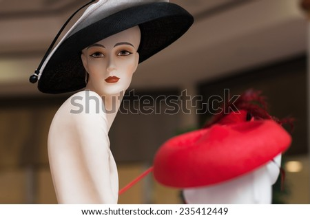 Fashion mannequin at the mall. luxury clothing store. Grain added - stock photo