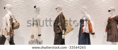 Fashion mannequins in window - stock photo
