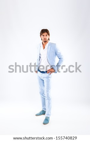 Fashion men, male model wear blue suit, young man full length portrait over gray background