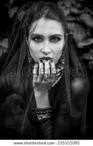 Fashion model dressed in gothic dark style. Vamp.