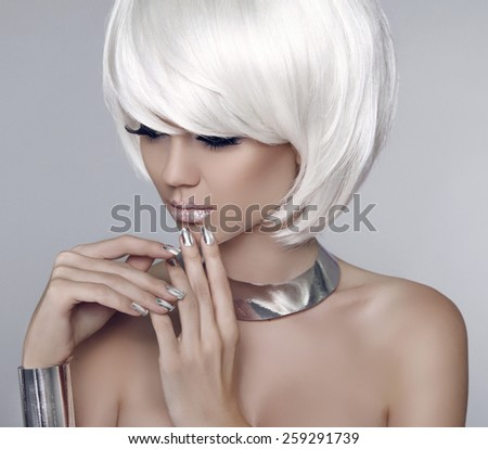 Fashion model girl face. Bob white short hairstyle. Beauty woman make up and manicure.  Blonde woman posing over grey background. - stock photo
