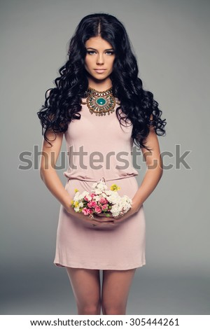Fashion Model Girl in Little Pink Dress. Brunette Woman with Curly Dark Hair - stock photo