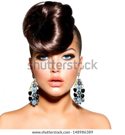 Fashion Model Girl Portrait with Blue Eyes and Earrings. Creative Hairstyle. Hairdo. Make up. Beauty Woman isolated on a White Background  - stock photo