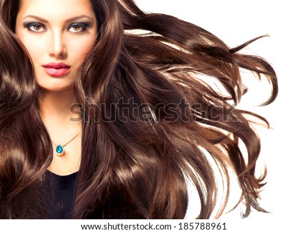 Fashion Model Girl Portrait with Long Blowing Hair. Sexy Glamour Beautiful Woman with Healthy and Beauty Brown Hair isolated on a white background. Flying long hair - stock photo