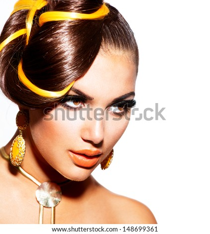 Fashion Model Girl Portrait with Yellow and Orange Makeup and Earrings. Creative Hairstyle. Hairdo. Make up. Beauty Woman isolated on a White Background - stock photo