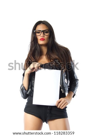 Fashion model holding a blank paper - Beautiful tall brunette model with a serious look on her face holding a vertically oriented blank sheet of paper, shot on white background - stock photo