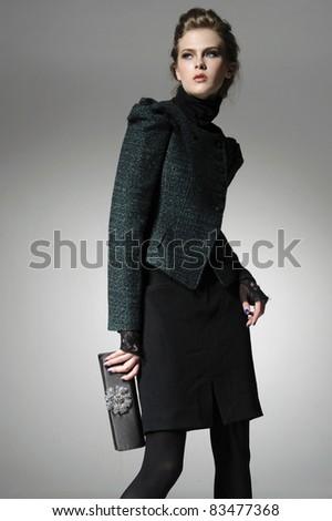 fashion model holding little purse posing - stock photo
