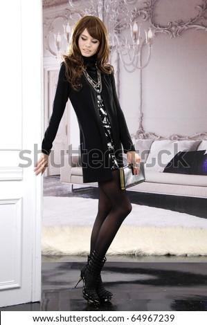 fashion model holding little purse shot in studio - stock photo