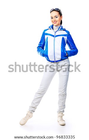 Fashion model in a coat posing at the studio. Isolated over white.